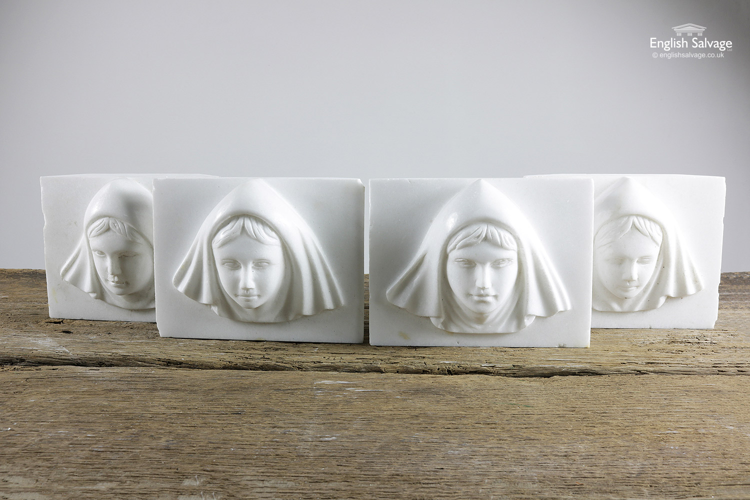 White Marble Carved Heads Plaque