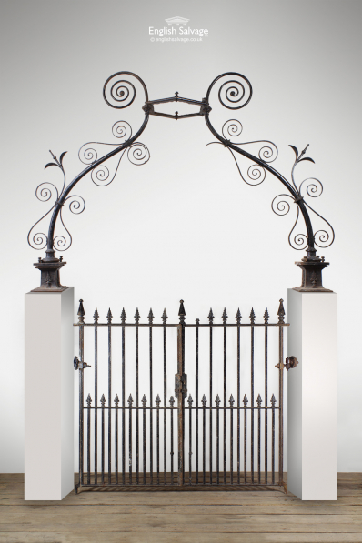 Antique Double Gates with Ornate Arch