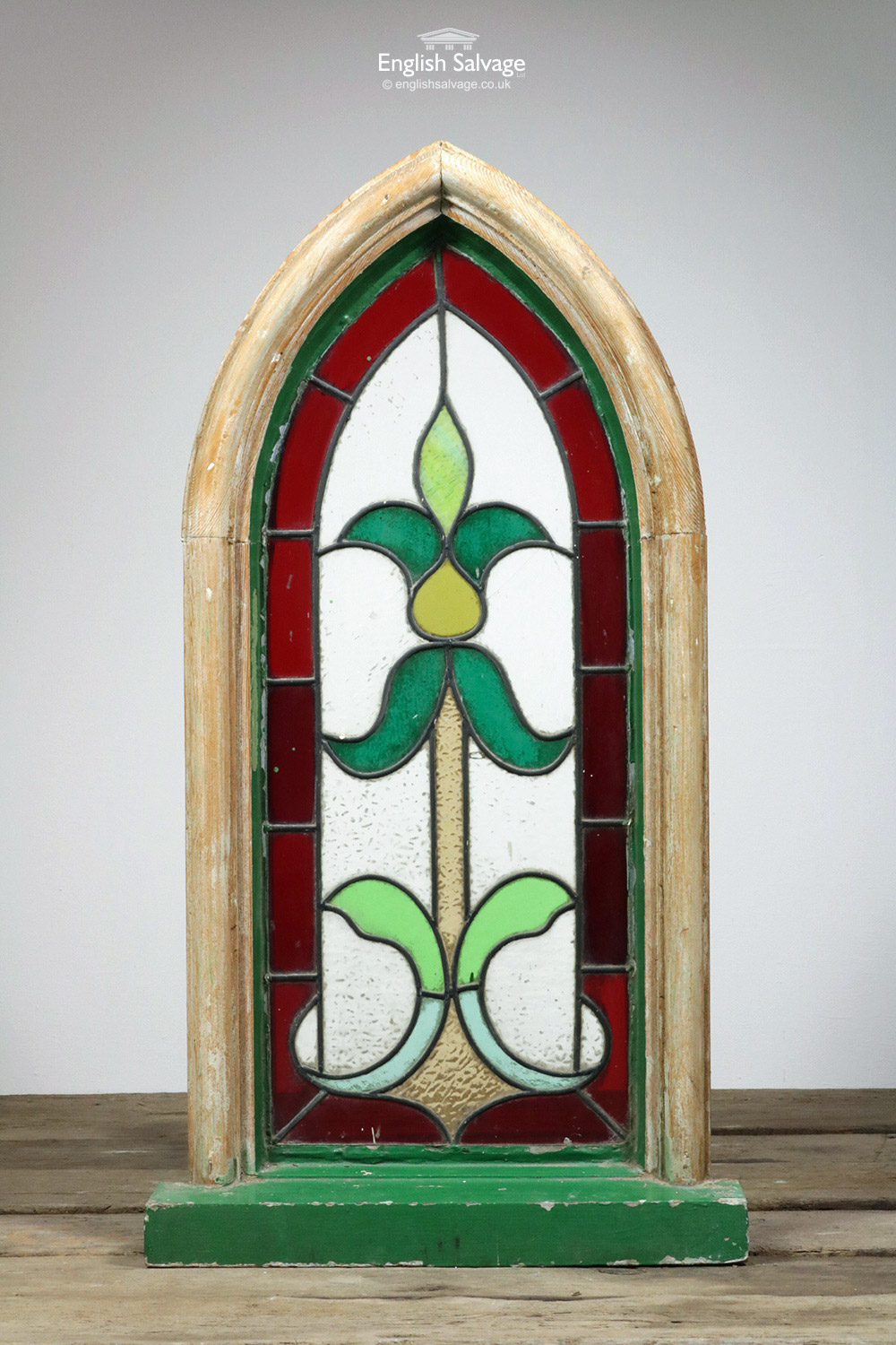 Wooden Arched Green Red Stained Glass Window