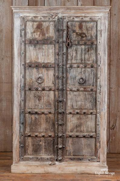 Dark hardwood cupboard with antique doors