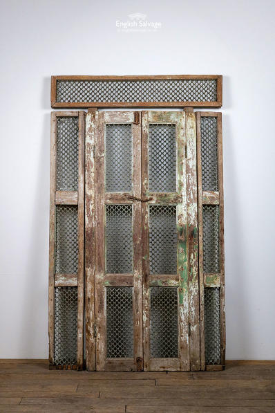 Double hardwood doors with wirework detail