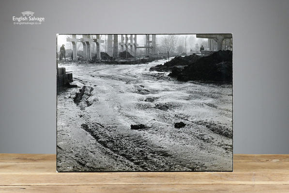 Large black and white photo titled Mud