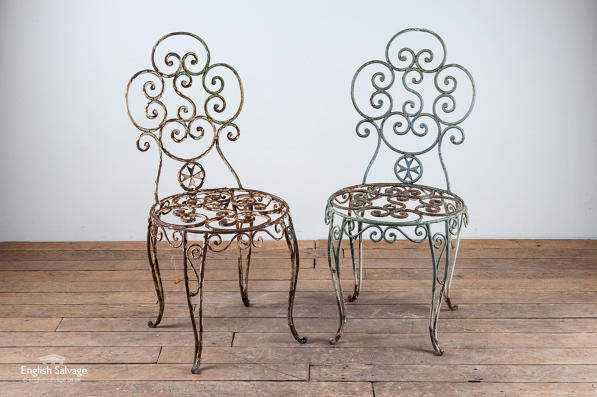 Pair of reclaimed elegant scrollwork chairs