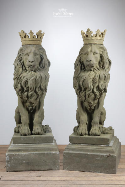 Pair stone lions with crowns on plinths