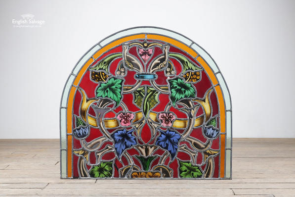 Reclaimed stained glass arched panel