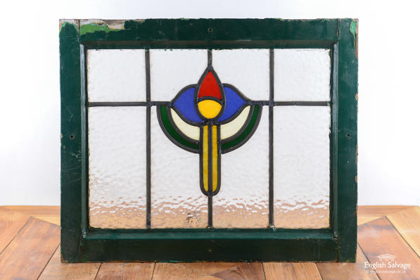 Reclaimed stained glass window in frame
