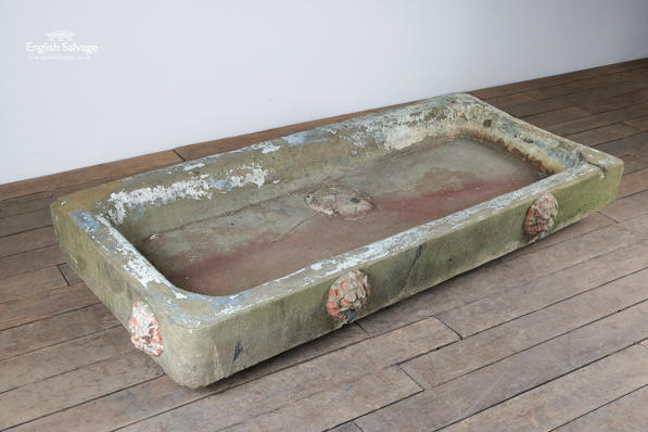 Reclaimed stone garden sink with lion heads