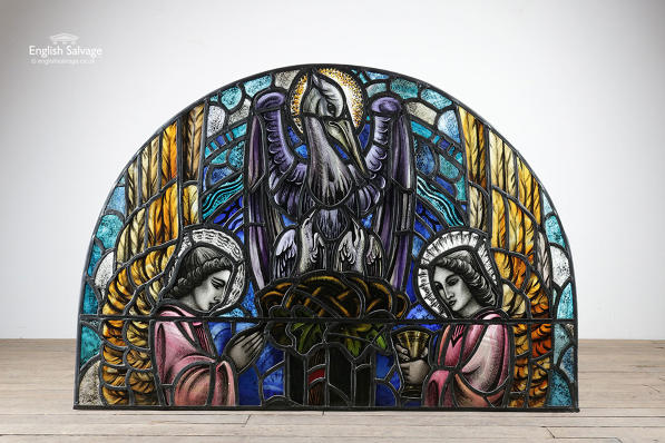 Restored religious arched stained glass