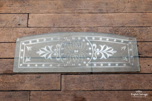 Salvaged etched glass panel with arched top