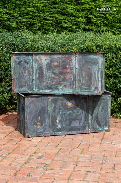 Substantial patinated riveted copper troughs